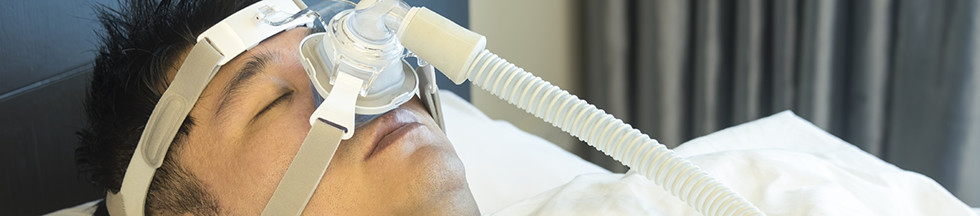 Person sleeping with breathing machine