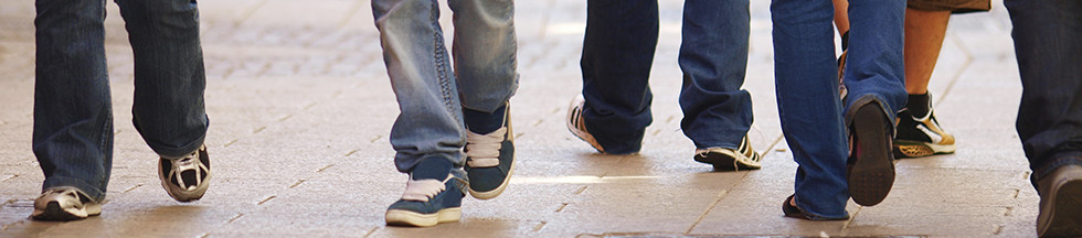 Young people showing shoes and jeans