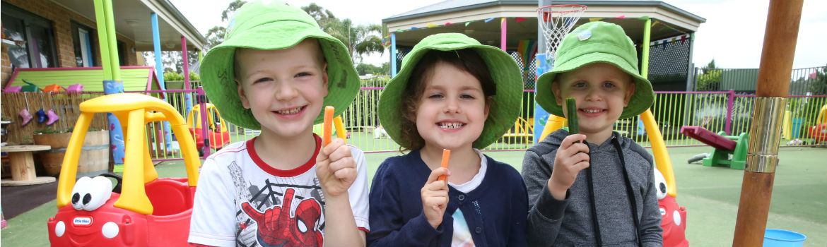 children holding vegetable sticks