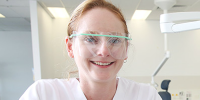 Westmead centre for oral health young dental technician wearing goggles