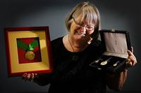 2 Bev with her award from the President of Peru and her OAM medal