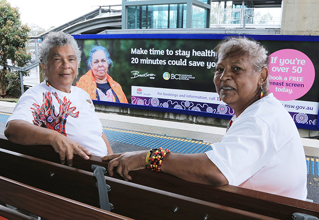 WSLHD BCI billboard breastscreen campaign with Aboriginal ladies. Left to right: Auntie Margareth Ferrow, Auntie Daisy Parker